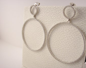 Rhodium Plated Sterling Silver Circular Earrings Set with Cubic Zirconias.