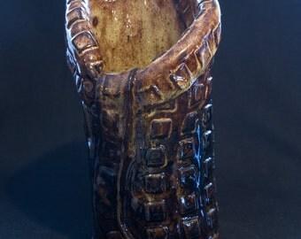 Handbuilt vase, textures with brown glaze.