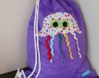 Kids swimming bag with octopus applique made from ripstop fabric which is shower proof.