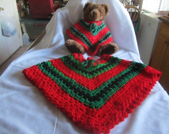 Child's Green, red and black poncho with matching teddy bear wearing his own poncho