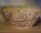 Serving Bowl with leaf garland and apple green glaze