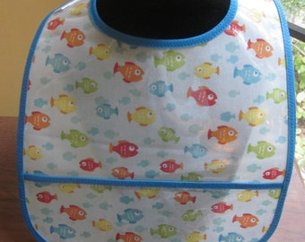 WATERPROOF WIPEABLE Baby to Toddler Plastic Coated Bib Fish on Blue