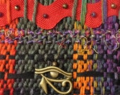 Hand Dyed Handwoven Tapestry in Cotton, Silk, Wool, Ric Rac, and Metal Eye of Ra Charm