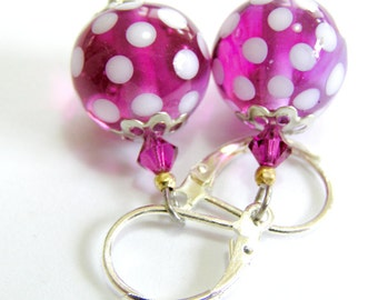 A pair of handmade lampwork earrings in pink and sterling silver