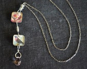One of a kind sterling and resin necklace with vintage imagery of bird and lotus flower