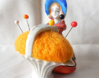 Vintage Colonial Girl wearing Big Hat Holding Basket Pin Cushion Made in Japan