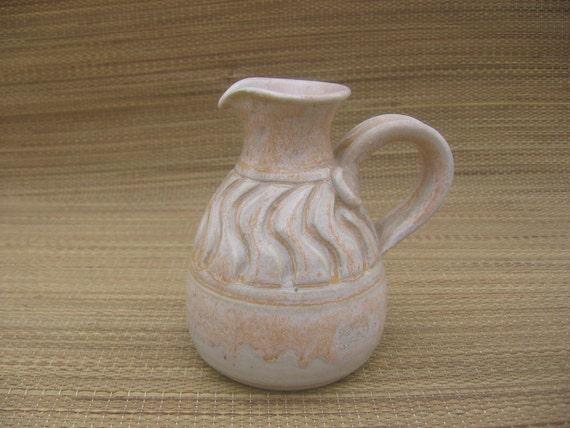 Charming handmade small pitcher