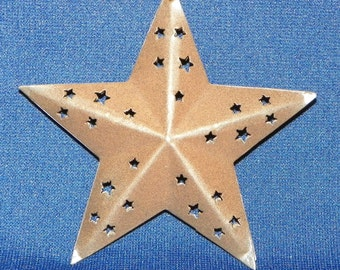 Metal Star, a 3-D Rust Finished Metal Primitive Star with Star cutouts, 3 5/8 Inches Across