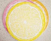 Set of eight lemon yellow letterpress coasters