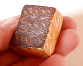 Tiny tile, metallic rust, dark chocolate colored tile with etched line drawing in yellow, miniature
