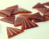 Mysterious carnelian red fan shaped plastic cabs, ribbed, vintage