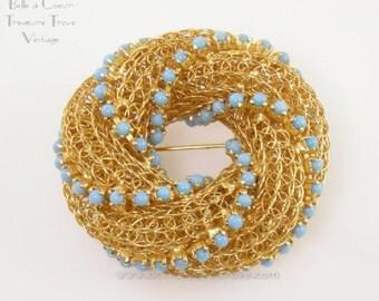 Vintage Goldtone and Light Blue Swirl Circle Pin Designer Signed Vogue