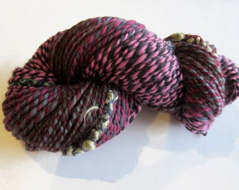 163 yds, bulky handspun yarn, 2 ply with wrapped locks, 'Trapped No. 1'