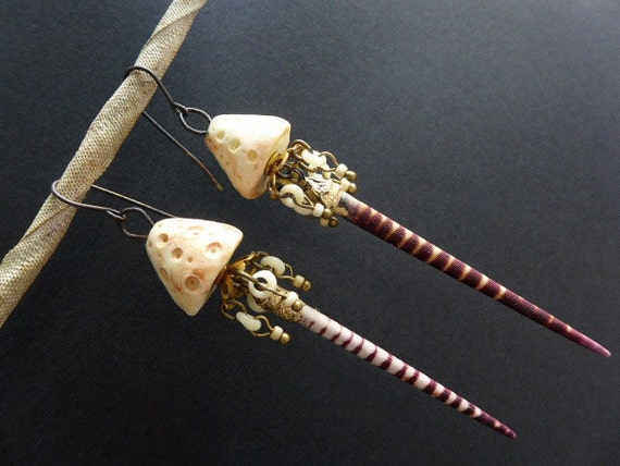 Spinning. Rustic assemblage earrings with urchin spines.
