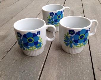 Retro flower power stacking coffee mugs
