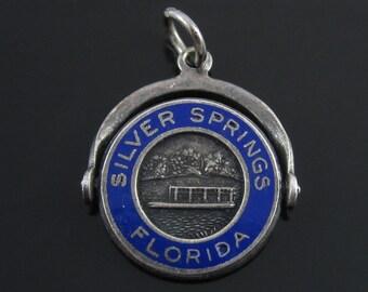 Vintage Silver Spring Florida Sterling Enameled Spinner Charm.