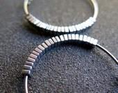 hammered silver hoops. niobium hoop earrings. hypoallergenic jewelry.