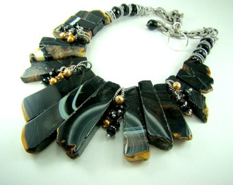 Chunky gemstone statement necklace, black zebra agate, black onyx, golden pearls
