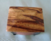 Distinctive Red Pashaco graces the top of this Peruvian exotic wood mini box.