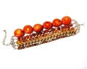 Burnt orange tones beaded multi strand bracelet