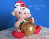 Red Elf Baby's First Christmas Ornament holding Gold Ball ( Personalized with baby's name) Baby's 1st xmas