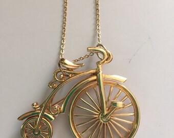 Bicycle brooch necklace