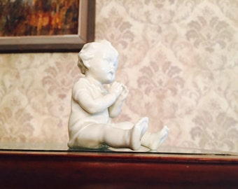 Porcelain Baby clapping