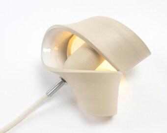 Ceramic Table lamp: a illuminating sculpture