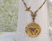 vintage elephant locket, BEST OF FRIENDS, baby elephant and sparrow bird vintage locket necklace antiqued brass long chain