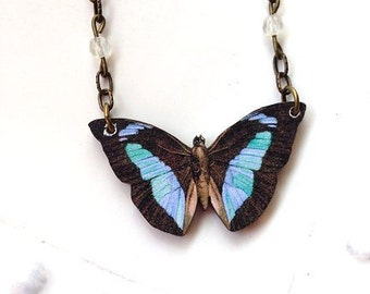 Butterfly necklace black and blue wings, moonstone colored crystal beads in chain