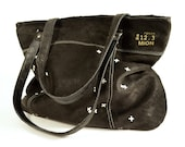 Black leather handbag with zipper and white print