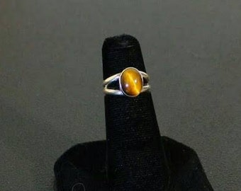 Sterling silver and tigers eye gemstone cabochon ring.