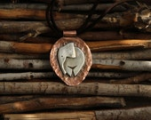 Baby elephant pendаnt. Silver figure on copper background. Boho pendant on suede.