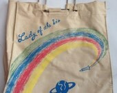 Out of this World awesome 1980s painted canvas tote bag .metal handles for the Lady of the 80s. Outerspace rocket and planet design