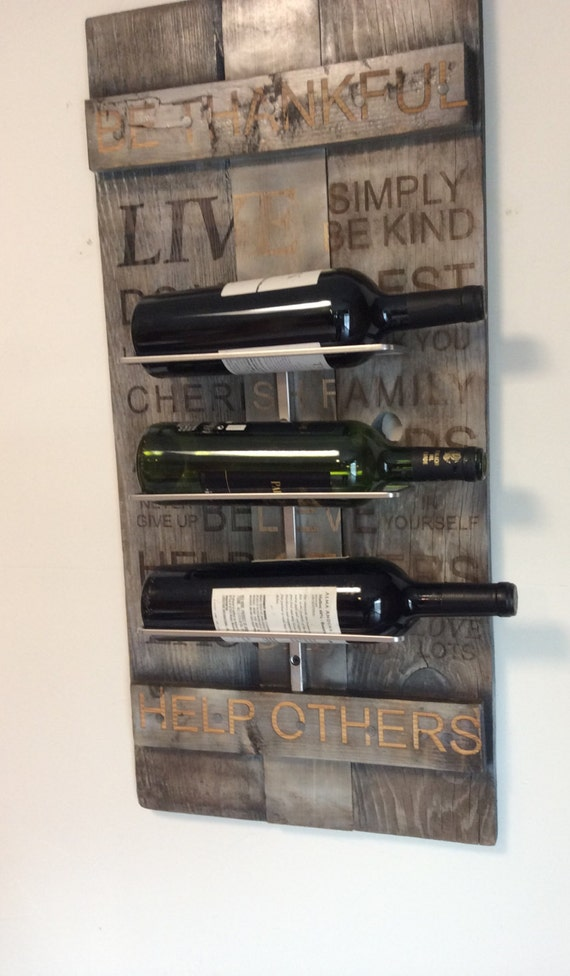 Hanging wooden wine rack on vintage wood crate Hanging wooden wine rack
