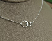 Tiny linked circles necklace in sterling silver, entwined rings, three linked circles, linked rings, tiny silver circles