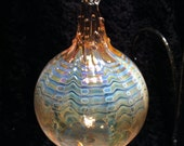 Silver and Gold fumed blown glass ornament by Fireworx Glass