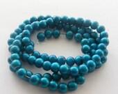 104 Blue glass beads B100