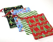 Reusable Fabric Holiday Gift Bags - Eco Friendly Gift Wrap in Fun and Festive Christmas Prints.  Set of Four.  Ready to Ship!!