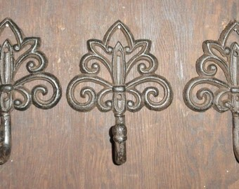 From Shabby to Chic Cast Iron Fleur de lis  wall hook, towel or coat rack vintage inspired bronze finish.