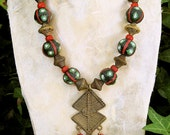 African Flower Beads Necklace Large Hand Painted Glass Beads Red Green on Black with African Cast Brass Pendant Ethnic African Jewelry
