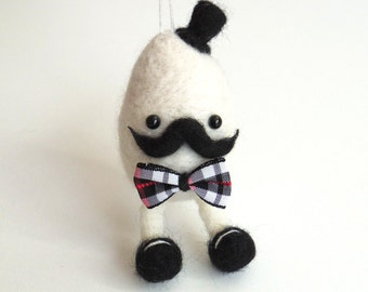 Needle felted egg ornament : felt mustache eggman - white egg with a black hat and bow tie.