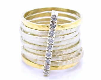 Stacking ring with hammered silver & gold band with 1 zircon bar