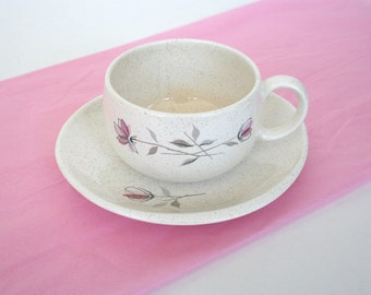 Mid century dish ware by Franciscan. Duet pattern, cups, saucers, ashtray, spoon rest, roses, pink, white, speckled glaze, Gladding Mc Bean.