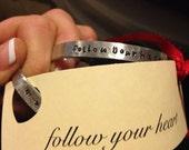 Follow your heart hand stamped aluminum cuff bracelet