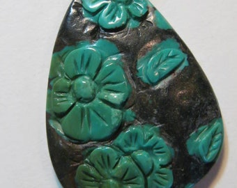 Spider Web Turquoise bead  ......  with lovely carved flowers .......  38 x 28 x 6 mm ... B1114