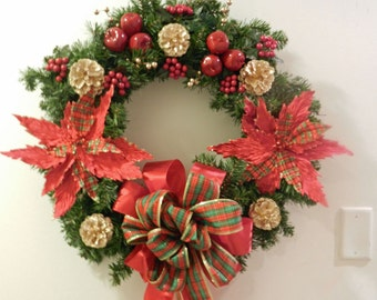 Large Christmas wreath red plaid poinsettia gold pine cones apples berries and plaid bow
