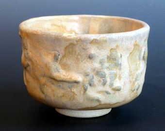 Yunomi Pottery Japanese Style Tea Cup with black iron slip decoration under a finely mottled flesh glaze.. George Watson