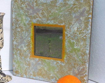 Hiding Lizard Mirror painted wide wood frame silver green lizards barely visible on gold silver design hand printed lizards 10 inch square