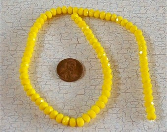 Small Opaque Yellow Crystal Strand